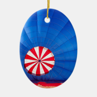 Blue Hot Air Balloon Inflating On The Ground Double-Sided Oval Ceramic Christmas Ornament