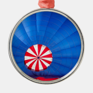 Blue Hot Air Balloon Inflating On The Ground Round Metal Christmas Ornament