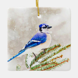 Blue jay in a pine tree with snow ceramic ornament