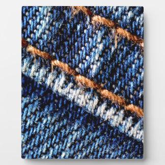 Blue jeans closeup texture. plaque