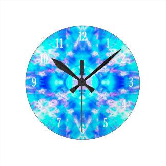Blue kaleidoscope pattern round clock