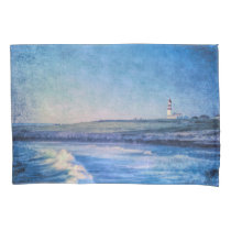 Blue lighthouse in evening and ocean waves pillow case