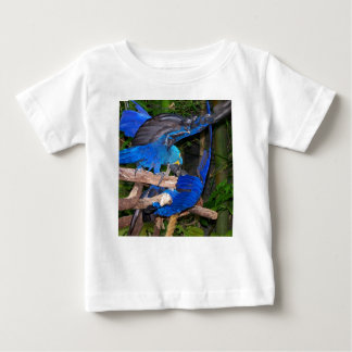 Blue macaw parrots fighting photograph picture baby T-Shirt