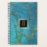 "Blue Marble Gold Laced Monogram Planner<br><div class=""desc"">This cover on this notebook planner has a faux marble background that adds a bit of gilded gold laced through a blue background. At the center is your monogram in gold on a black square banner that is double lined in matching gold. The back cover has the same blue faux...</div>"