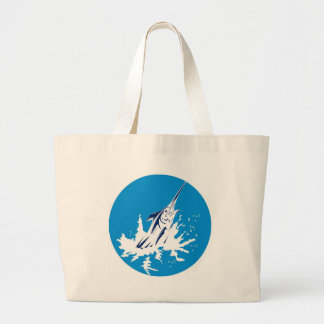 Blue marlin jumping tote bags