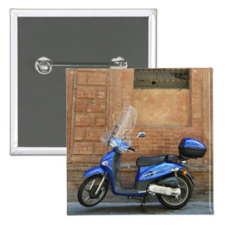Blue motor scooter by red wall, Siena, Italy Button