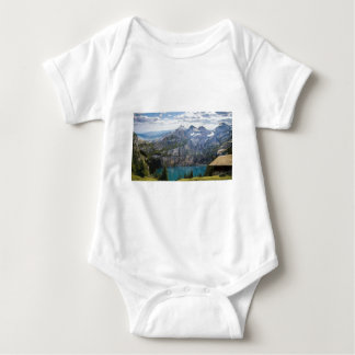 Blue mountain lake  oeschinen pond in nature baby bodysuit
