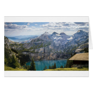 Blue mountain lake  oeschinen pond in nature card