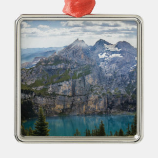 Blue mountain lake  oeschinen pond in nature metal ornament