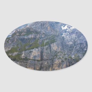 Blue mountain lake  oeschinen pond in nature oval sticker