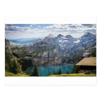 Blue mountain lake  oeschinen pond in nature postcard