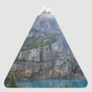 Blue mountain lake  oeschinen pond in nature triangle sticker