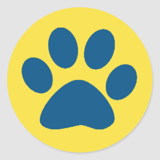 blue paw print on yellow background classic round sticker