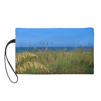 Blue peacock just grass clear sky wristlet