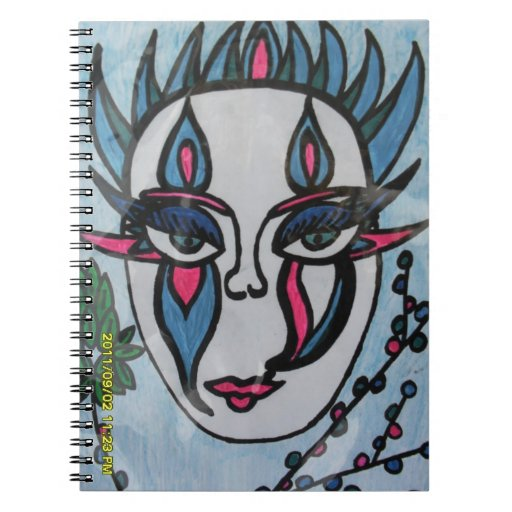blue/pink mask on notebook