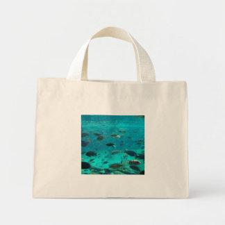 Blue pool of cichlids swimming around design mini tote bag