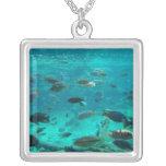 Blue pool of cichlids swimming around design custom necklace