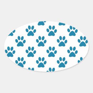 Blue puppy paw prints pattern oval sticker