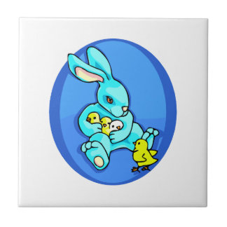 blue rabbit three chicks holding one chick out.png ceramic tile