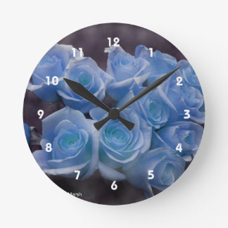 Blue Rose colorized bouquet spotted background Round Clocks