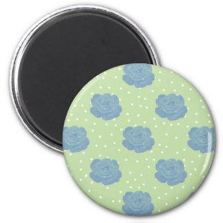 Blue rose pattern on green backround magnet