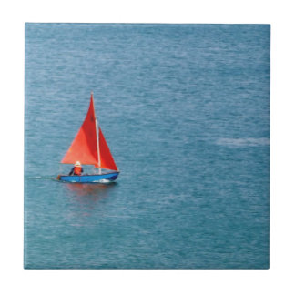 Blue Sailboat with Red Sail at Coverack Cornwall Ceramic Tile