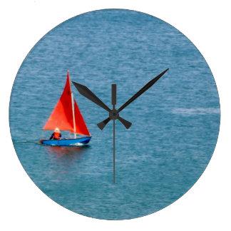 Blue Sailboat with Red Sail at Coverack Cornwall Large Clock