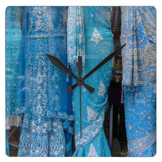 Blue Saris in a Store Window, Paris Square Wall Clock