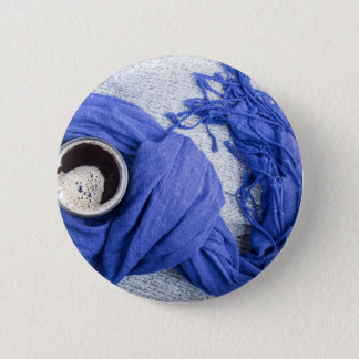 Blue scarf tied around the mug with hot coffee button
