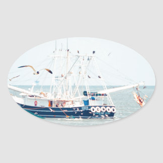 Blue Shrimp Boat on the Ocean Oval Sticker