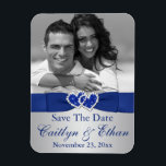 """Blue, Silver Hearts Save the Date Photo Magnet<br><div class=""""desc"""">This royal blue and silver gray photo save the date magnet has a PRINTED satin LOOK ribbon and bow on it, with a pair of PRINTED diamond jewel and FAUX glitter (simulated) joined hearts on it that matches the wedding invitations shown below. The text is customizable. Upload your own digital...</div>"""