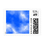 Blue sky with white clouds. postage stamp