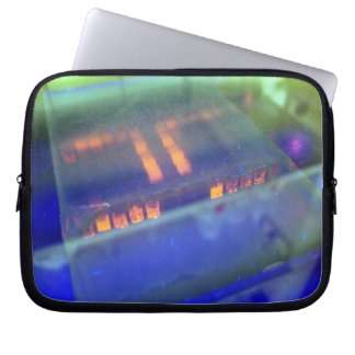 Blue solution in glass vessel computer sleeve