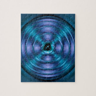 Blue spinning atom jigsaw puzzle