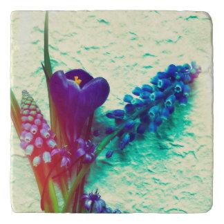 Blue spring flowers on texture trivet