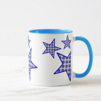 Blue star flowers on white in pattern on a mug