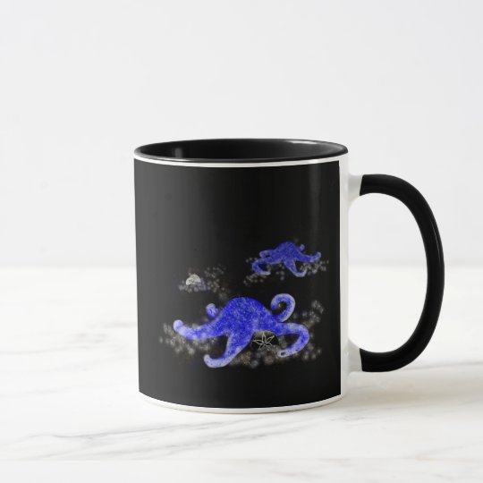 Blue Starfish on black background mug