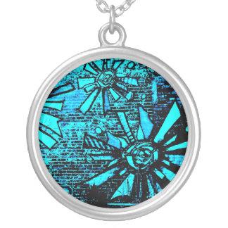 blue sun is a monochromatic burst of color waves round pendant necklace