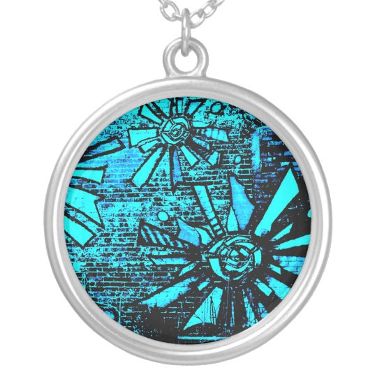 blue sun is a monochromatic burst of color waves silver plated necklace