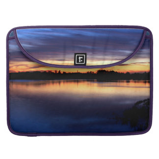 Blue sun putting in the lagoon. Rocío and Doñana MacBook Pro Sleeve