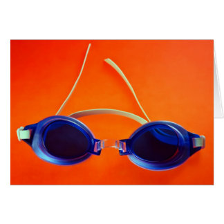 Blue Swimming Goggles on Orange Greeting Card