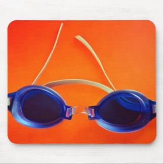 Blue Swimming Goggles on Orange Mouse Pad