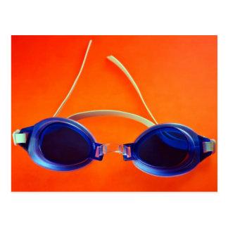 Blue Swimming Goggles on Orange Postcard