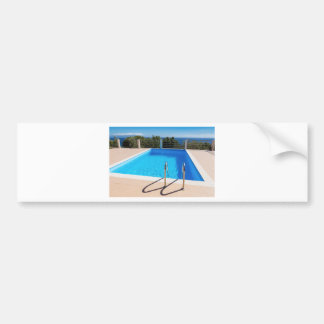 Blue swimming pool with steps at sea bumper sticker