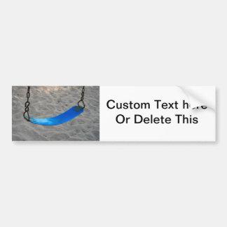 blue swing against sand swingset playground bumper sticker