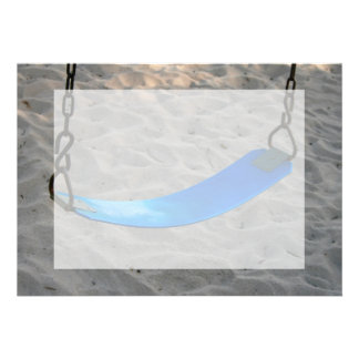 blue swing against sand swingset playground announcement