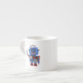 Blue toy robot waving hello espresso cup