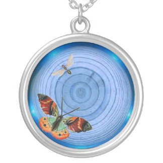 blue tree rings with insects necklace