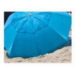 blue umbrella on the beach postcard