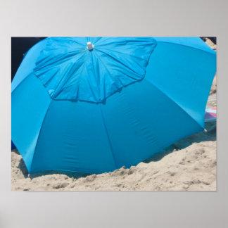 blue umbrella on the beach poster